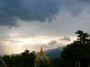 Wat Padet And Clouds Over The Mountain