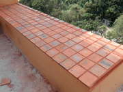Edge Of Balcony On Seventh Floor Tiled With Terracotta And Red Grout