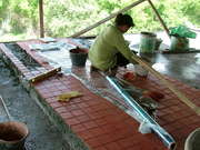 Grouting Terracotta Tiles On The Seventh Floor Front Balcony