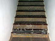 The Seventh Floor Staircase Finished In Wood And Marble and Covered In Plastic Film
